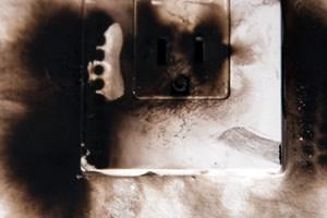 singed plug socket showing risk of major fire